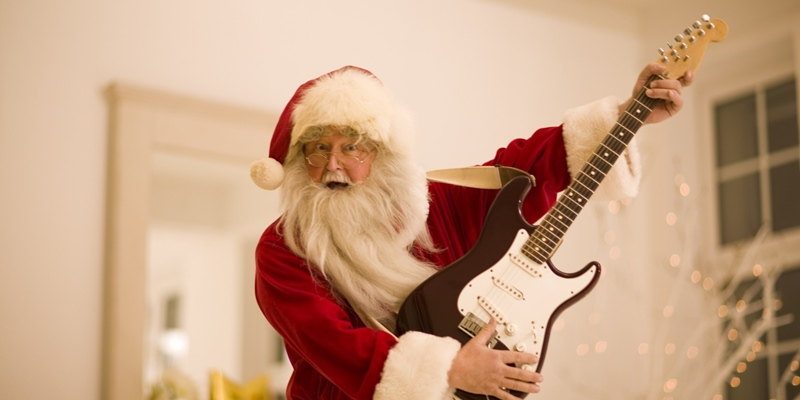 Santa Claus playing electric guitar on Christmas