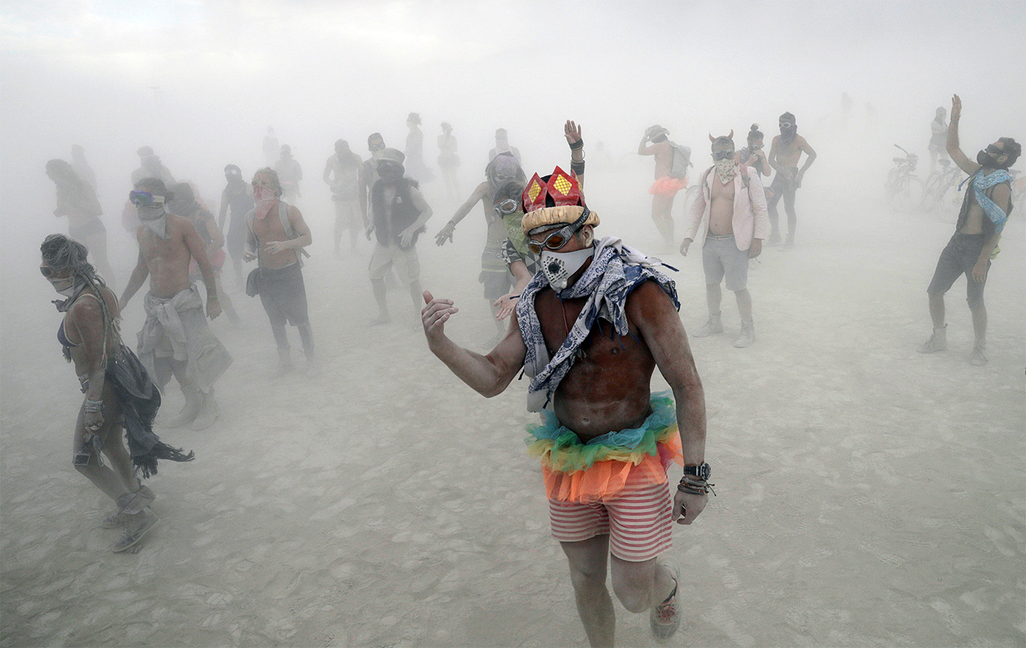 Burning Man participants dance to the music of an art car in the midst of a driving desert dust storm on the 2nd day of the annual Burning Man arts and music festival in the Black Rock Desert of Nevada, U.S. August 29, 2017. REUTERS/Jim Bourg   FOR USE WITH BURNING MAN RELATED REPORTING ONLY. FOR EDITORIAL USE ONLY. NOT FOR SALE FOR MARKETING OR ADVERTISING CAMPAIGNS. NO THIRD PARTY SALES. NOT FOR USE BY REUTERS THIRD PARTY DISTRIBUTORS. - RTX3DX64