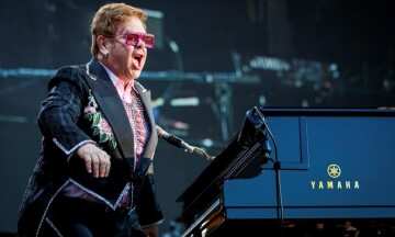 """British singer Elton John performs on the stage of the """"stade de la Saussaz"""" during his final """"Farewell Yellow Brick Road"""" tour at the 53rd Montreux Jazz Festival (MJF), in Montreux, Switzerland, Saturday, June 29, 2019.  THE CANADIAN PRESS/Valentin Flauraud/Keystone via AP"""