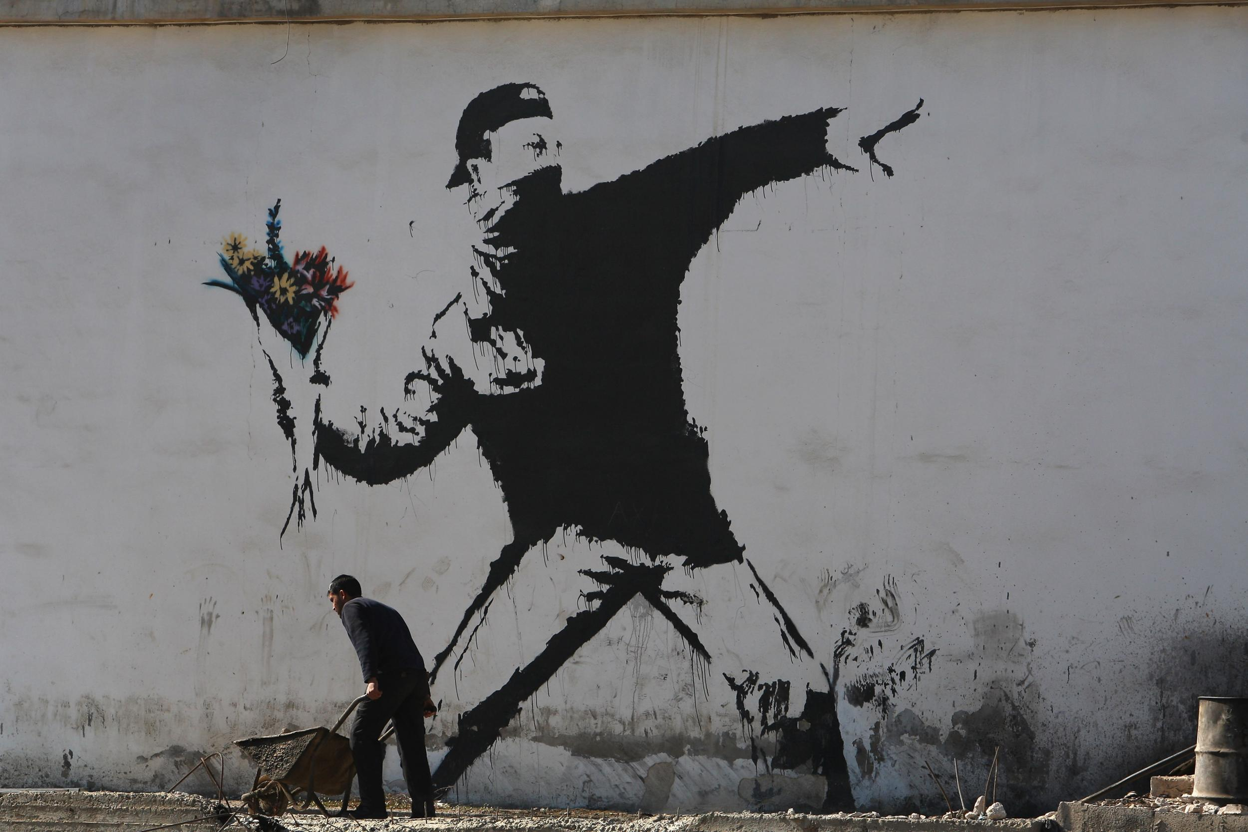 banksy-looses-copyright-to-his-west-bank-artwork